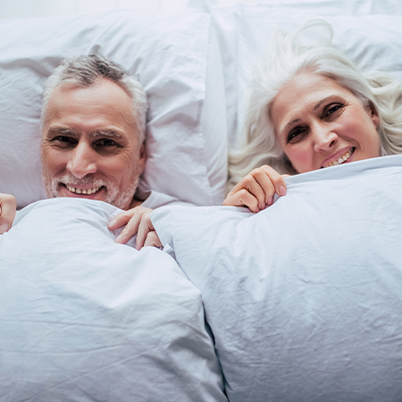 Happy senior couple getting ready for bed