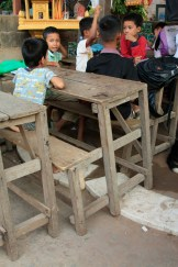 the desks are very rudimentary - they will get new desks in May, along with a more stable floor (concrete)