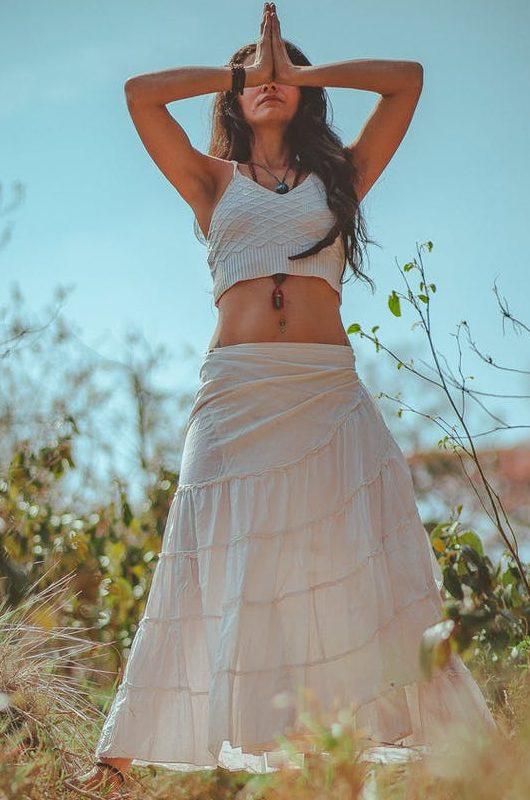 woman in white tank crop top on grass field
