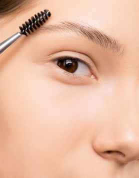 picture of woman maintaining eyebrows