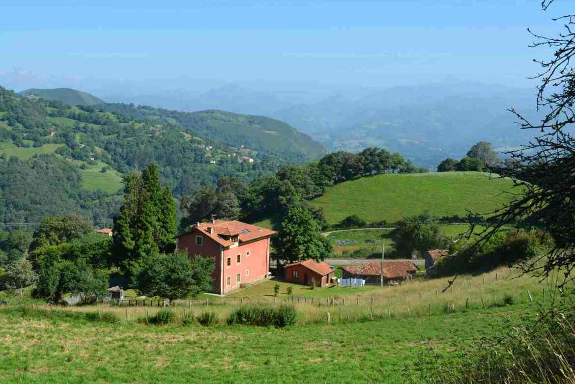 A red house looking over the valley