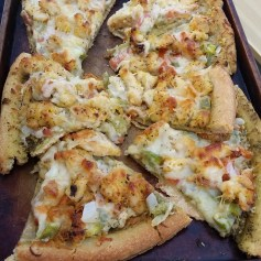 Healthy Pizza: Ingredients:- 1 pizza crust [My favorite brand is Mama Mary's, Thin & Crispy]- 4 tbsp pesto sauce- 1 ½ cups mozzarella cheese- ½ cup chopped green pepper- ¼ cup chopped onion- 1 tbsp minced garlic- ¼ cup chopped tomato- 1 boneless, skinless chicken breast - 2 tbsp olive oilFor the chicken:- 2 tbsp olive oil - ¼ cup flour - 3 tbsp lemon pepper seasoning