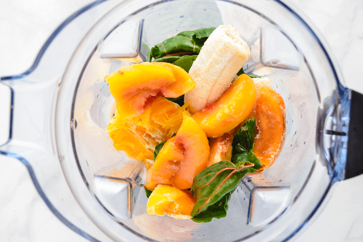 add swiss chard and fruit to blender