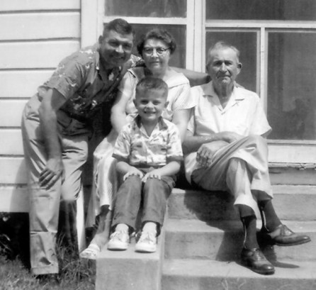 Jim and his dad and his dad's parents at the home in Port Gibson in 1960.