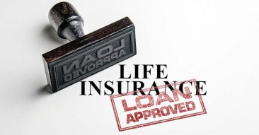 Rubber stand laying on its side with Loan Approved stamped over the words Life Insurance. Use Life Insurance for the downpayment for your house.