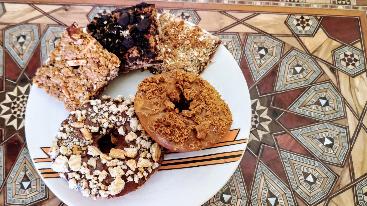 Bites of Granola Bars and Donuts with chocolate and cookies on a plate