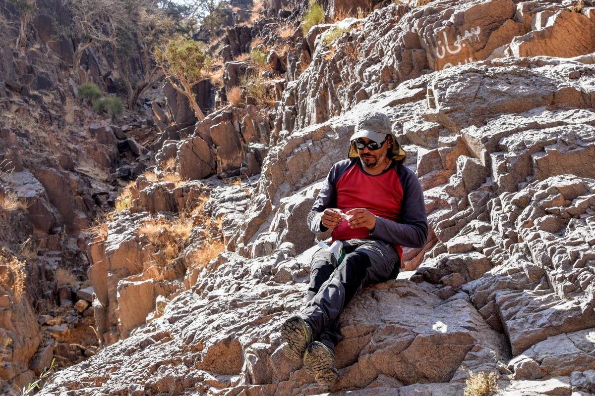 Guy sitting on rocks