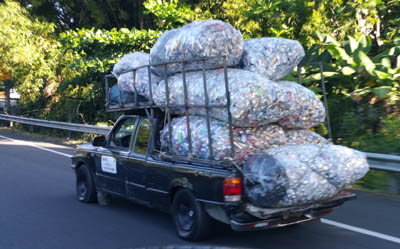 Cans stacked for recycling - 30 (Crazy) Things You Will See Driving in Puerto Rico