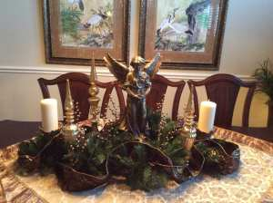 Table scape for the dining room table I created yesterday. I had the left over ribbon, garland, and candles.
