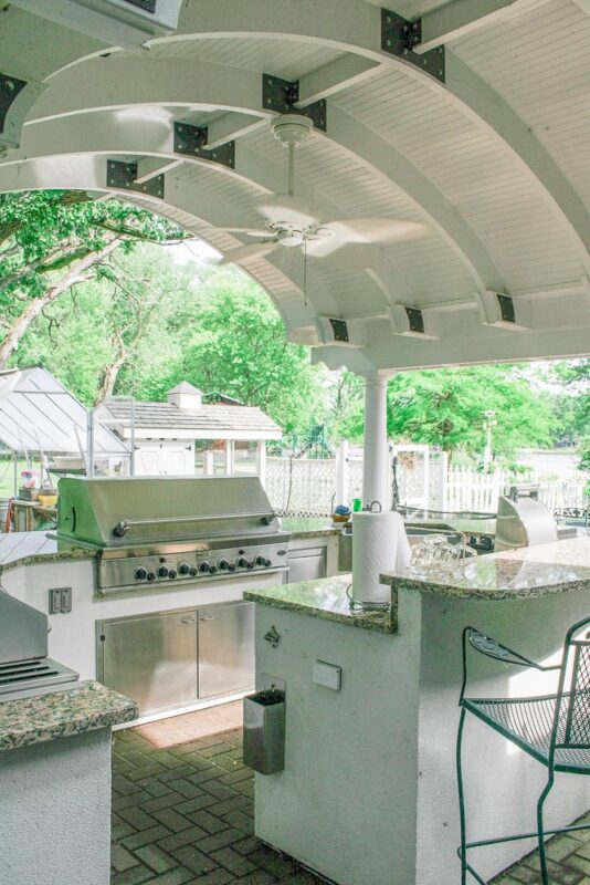 White outdoor kitchen with arched top roof made by my handy husband