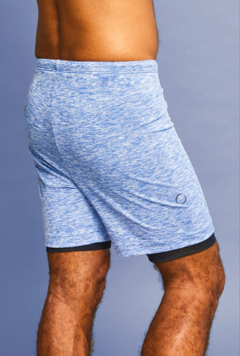 Image of a pair of blue Ohmme 2-dogs yoga shorts for men.