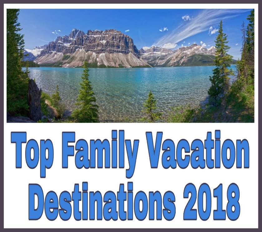 Top Family Vacation Destinations 2018 image of beautiful clear blue water, blue skies, mountains in background and green evergreens bordering the edge of the photo.