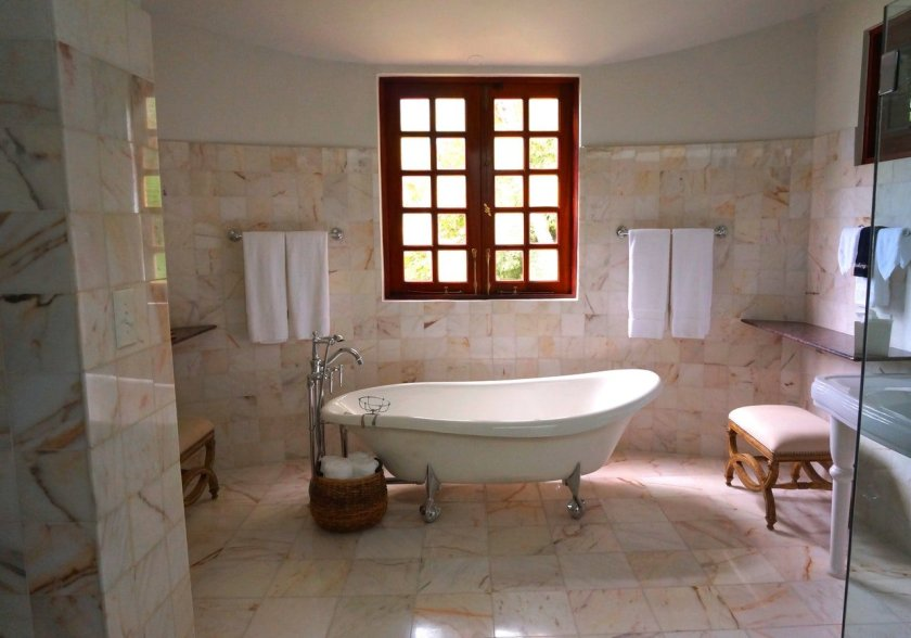 A lovely bathroom with typical bathroom features including a comfy stool