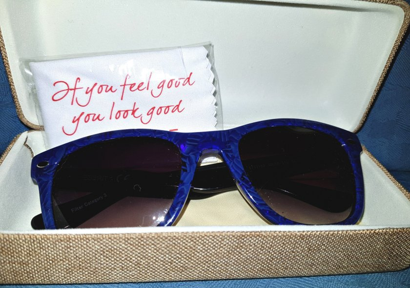 An image of Espirit sunglasses in case. 'If you feel good, you look good' quote.