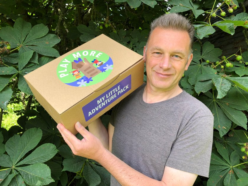Chris Packham holding a Play More box