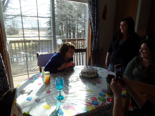 Mom is an expert at blowing out candles.