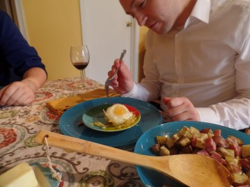 Jon inspects the egg in the nest, apprehensive.