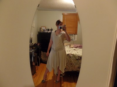 Using two long strips of fabric with the pinstripe going vertical, I put this little ditty together.