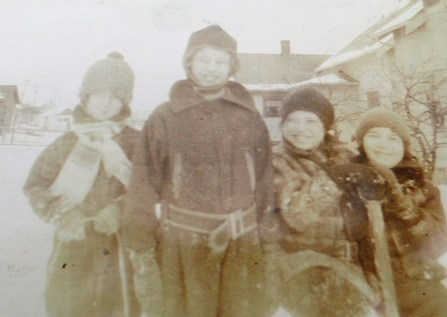 My grandmother and her sister (left) with friends in their snow suits made from the upholstery of their dad's car.