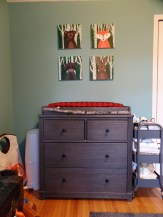 Paintings were done by my talented sister based on a few different sets I saw on Pinterest. Changing table and cart from Target.