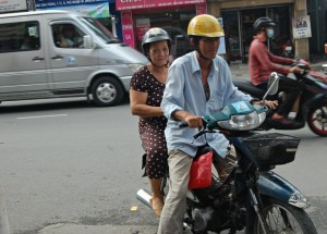 A Man helps a lady for Free Motorbike service.