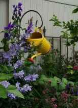 70 Creative and Inspiring Garden Art From Junk Design Ideas For Summer (68)
