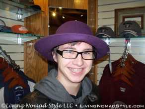 Noah Goofing Around With Hats In Wine Store