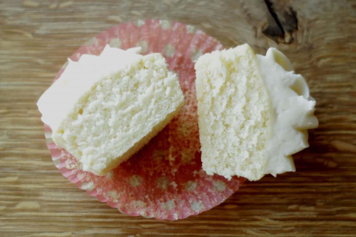 vanilla cupcake cut in half to show soft, fluffy interior