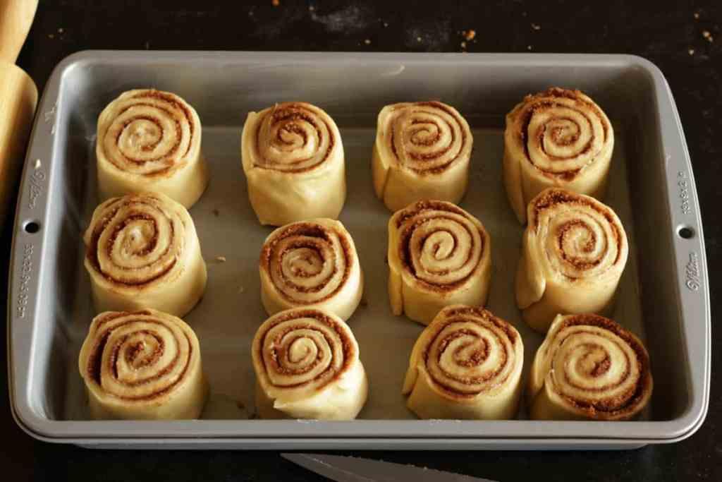 12 raw cinnamon rolls in rectangular pan