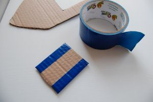 To make your toy boat water tight, cover the pieces with duct tape