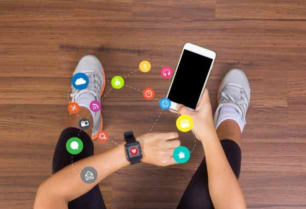 Fitness woman hand with application icons wearing watchband touc