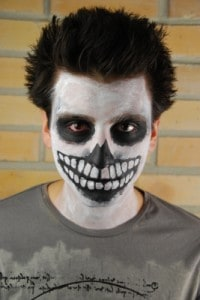 Creative types can create a scary skeleton costume using only face paint. Photo by artur84, freedigitalphotos.net.