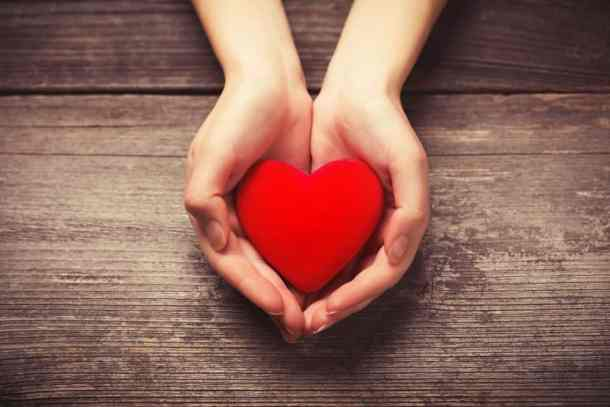 Valentine's Day deals: image of two hands holding a heart