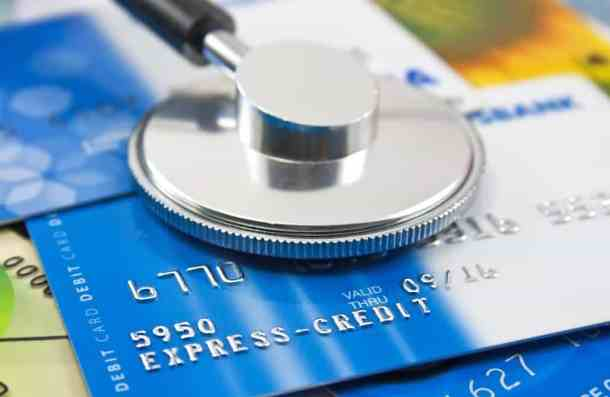 A stethoscope by a Credit cards