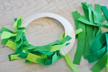 paper plate wreath craft - tie felt strips and slide 2