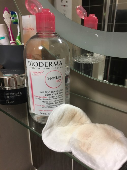 Afterspa Makeup Remover Cloth: The end of Cleansers? Picture of Bioderma Sensible and two cotton pads showing traces of makeup on a glass bathroom shelf