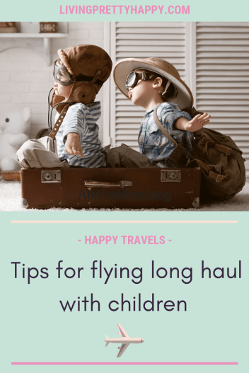 Tips for flying long haul with children. Pinterest graphic displaying post title on a background image of two young boys sitting in an open retro style suitcase wearing flying pilot outfits pretending to be in a plane. happy travels. livingprettyhappy.com