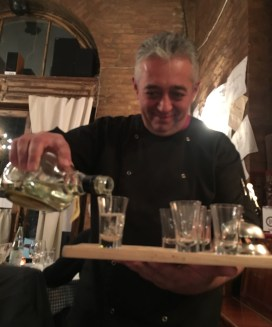 48 hours in Budapest. Image of the Host at the Chef Cafe Budapest pouring shots of the local liquor into shot glasses