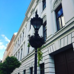 48 hours in Budapest: Image of a black lamppost surrounded with a hanging basket in front of a white building