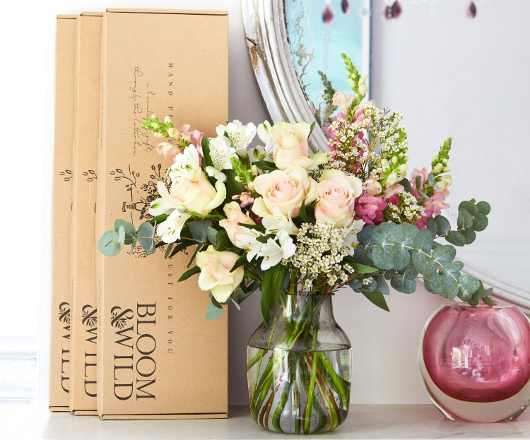 Blooming lovely: the positive power of flowers. Image of 3 Bloom & Wild letterbox boxes and a vase full of cream, pink and green flowers