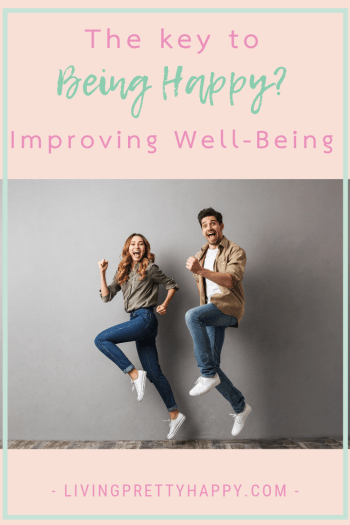 Improving well-being: The key to being happy? Pinterest graphic displaying post title over a background image of a cheerful young couple jumping together and celebrating success. Livingprettyhappy.com