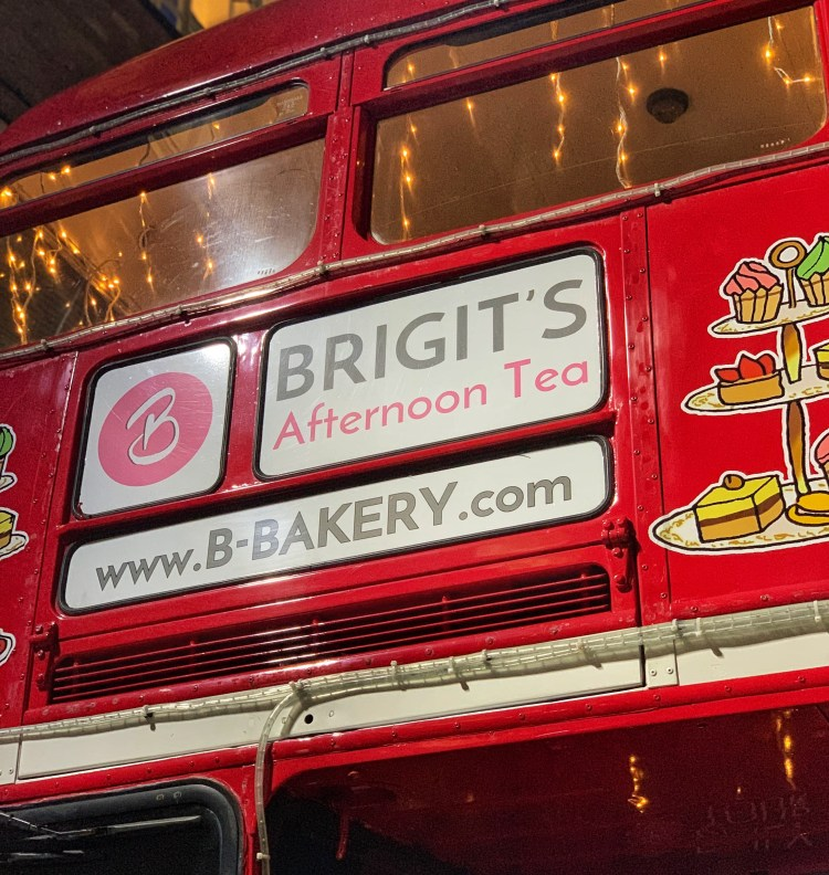 Happy Days: London Afternoon Tea Bus Tour. Image of part of the front of the B-Bakery Afternoon tea vintage bus