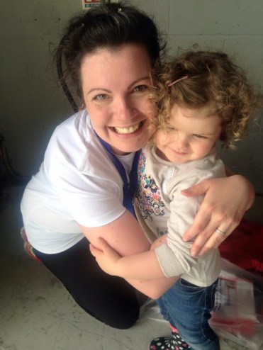 Why I run. Image of woman and little girl hugging and smiling