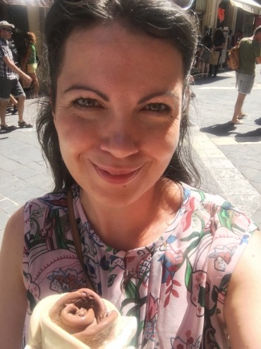 Happy Travels: Where you absolutely should go in Malta. Image of Alex Grace holding a flower icecream