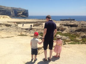 Happy Travels: Where you absolutely should go in Malta. Image of man, young boy and girl at Azure Window