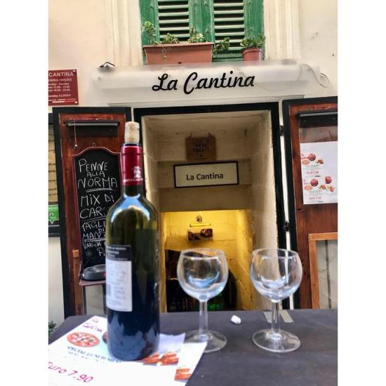 Happy Travels: Where you absolutely should go in Malta.  Image of entrance to La Cantina restaurant Valletta