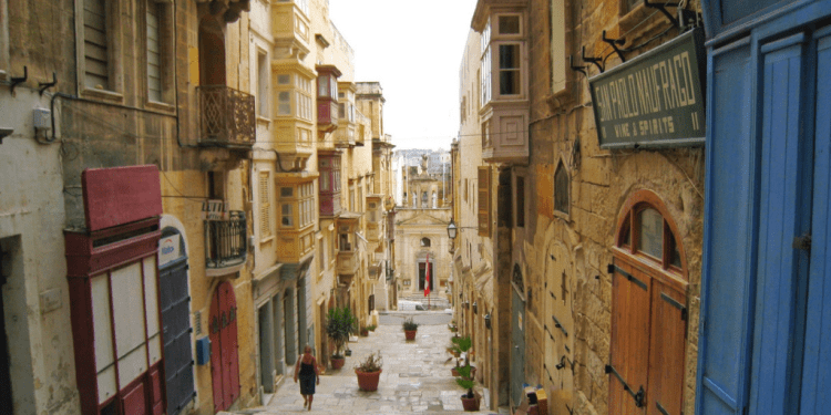 Happy Travels: Where you absolutely should go in Malta. Image of a Valletta side street
