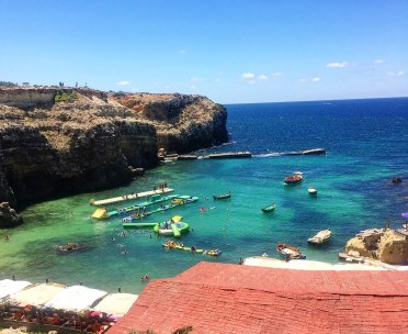 5 Fun kid-friendly things to do in Malta. Image of inflatable course in the sea at Popeye village Malta