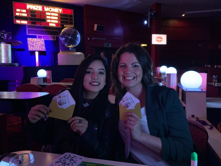 Let's give it a go: becoming more open to new experiences. Image of Abeer Says blog and Alex Grace, Living.Pretty.Happy at Player's Bingo Camden holding up their winnings