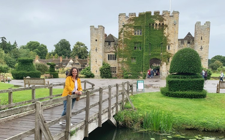 Alex Grace standing on a footbridge with Hever Castle in the background